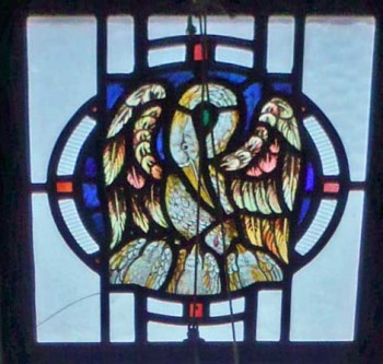 Detail of a stained glass window in the right hand side of the apse of St. Edward's church, Kettering, showing a pelican plucking its' breast