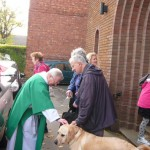 Deacon Keith greeting people after church at St. Edward's Kettering, October 2013
