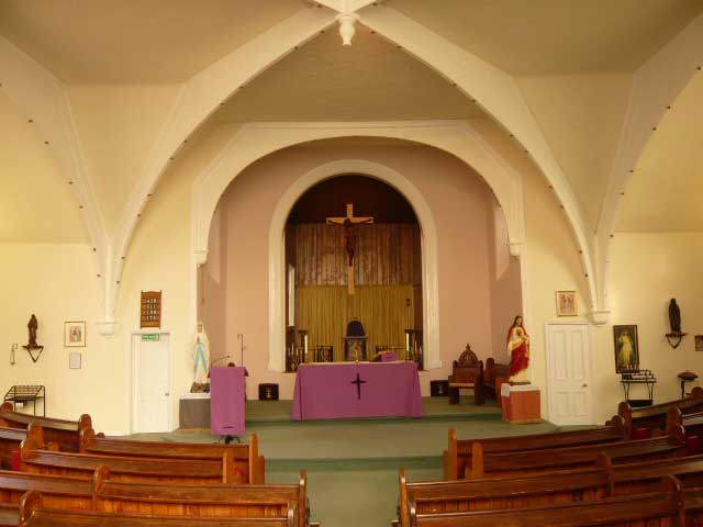 View of the altar of Holy Trinity Church, Desborough, from the pews