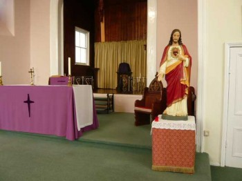 View of the altar and chancel with Sacred Heart statue, Holy Trinity church, Desborough
