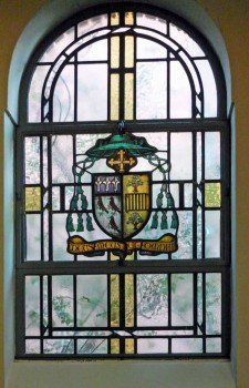 Stained glass window in St. Edward's Church with the coat of arms of Bishop Youens