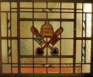 Stained glass window of Papal Insignia in the narthex of St. Edward's church, Kettering