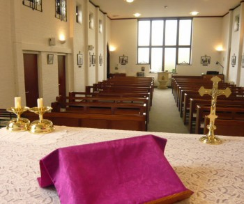Looking towards the congregation across the altar at St. Bernadette's Church, Rothwell