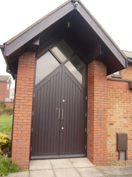Entrance door to St. Bernadette's church, Rothwell, 2013