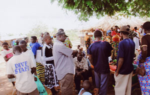 Fr. Joe gives a word of comfort to a small group of the Ugandan landslide survivors