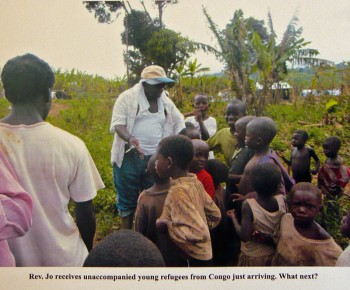 Fr. Jo receives newly arrives unaccompanied young refugees from the Congo, at Kyangwali Refugee Settlement 2013