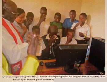 Fr. Jo blessing the new solar power system and computers at Kyangwali school 2013