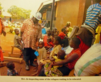 Fr. Jo inspecting some of the refugees waiting to be relocated