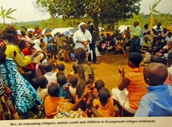 Fr. Jo welcoming refugees, mainly youth and children, to Kyangwali settlement