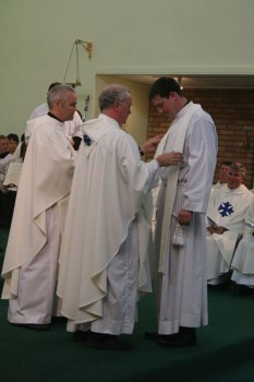 Vesting of Fr. Andy Richardson by Fr Mark Floody and Fr. John McArdle