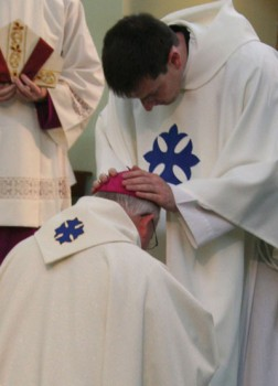 Bishop Peter receives a first blessing from Fr. Andy Richardson