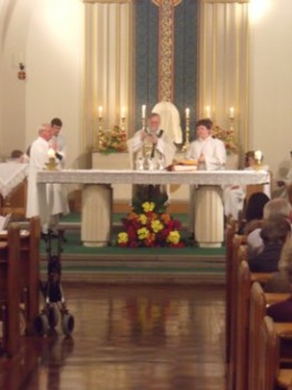 Canon John at the altar saying Mass for his 40th anniversary