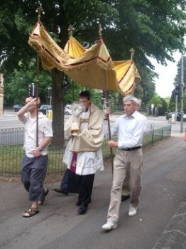 Fr. Andy Richardson carrying the Blessed Sacrament at the Corpus Christi Procession 2010