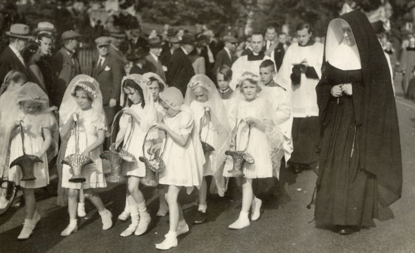 Children in white dresses strewing Petals at the 1940 Corpus Christ Procession, Kettering