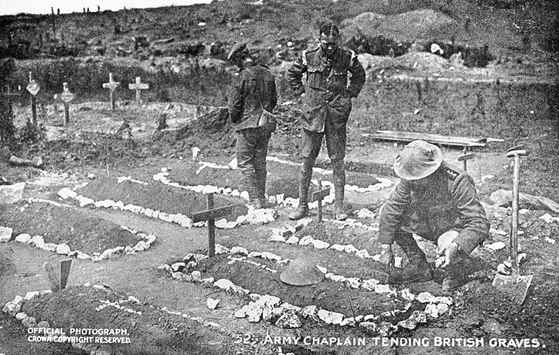 postcard picture of army chaplain tending British graves in first world war
