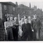 Langley family and visitors from St. Dominic's Infant School, Kentish Town, at 91 London Road after the war