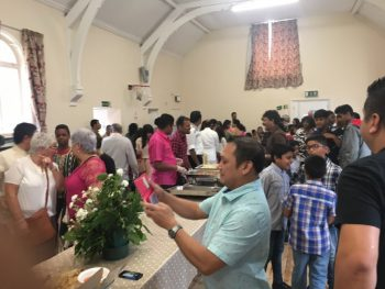 Sharing a meal after International Mass, July 2017