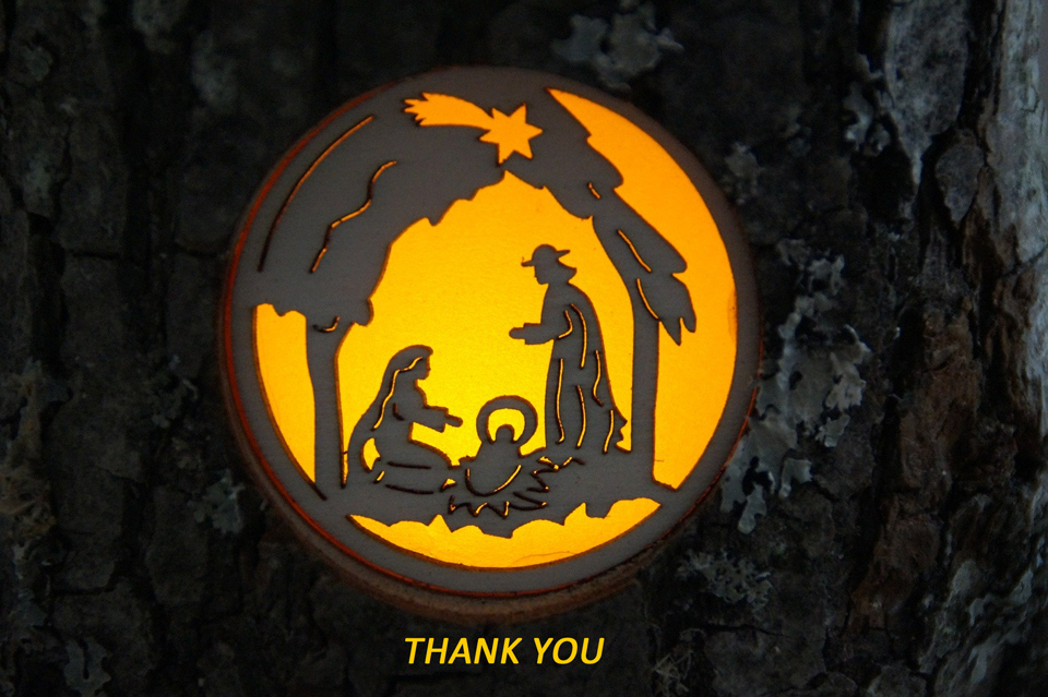 wood carved nativity scene with glowing amber background