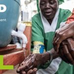 Women washing their hands in a Cafod appeal poster