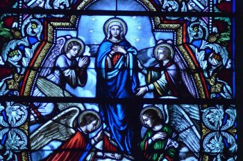 Detail from stained glass window picturing the Assumption of the Blessed Virgin Mary