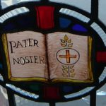 stained glass window pater noster and communion host