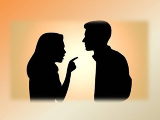 Silhouette of a woman and man arguing