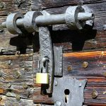 Bolt and padlock on an ancient door