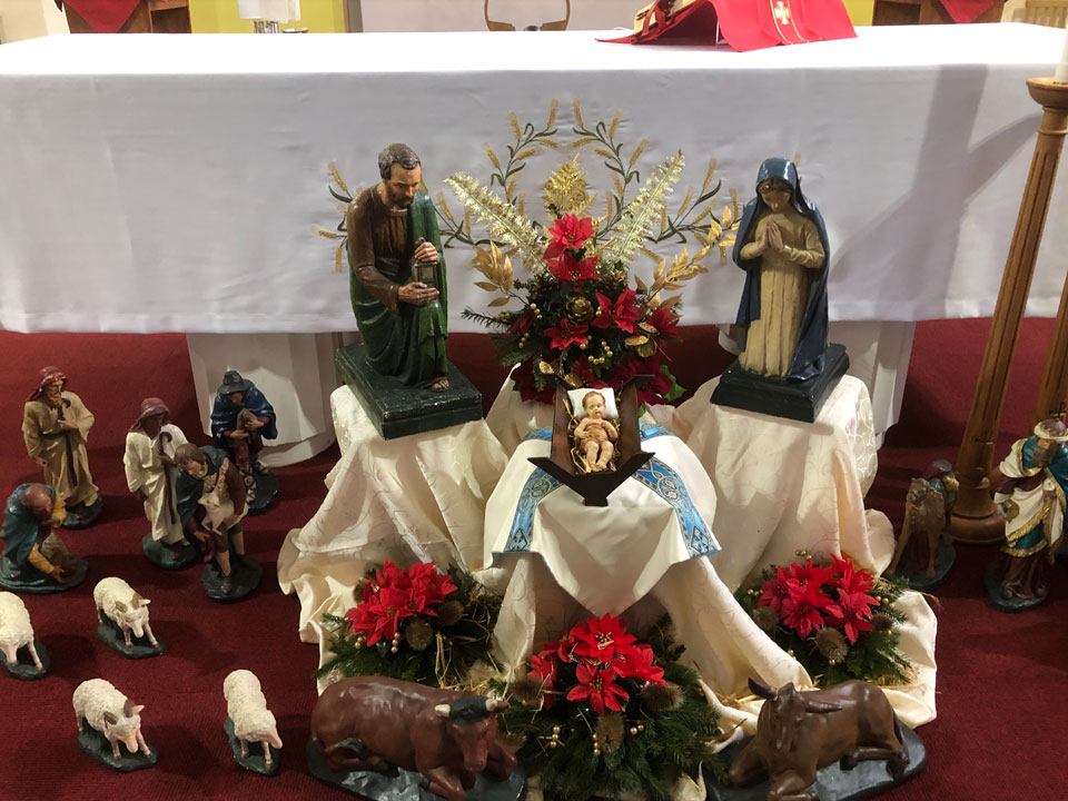 Nativity scene in front of the altar at St. Edward's Church, 2020