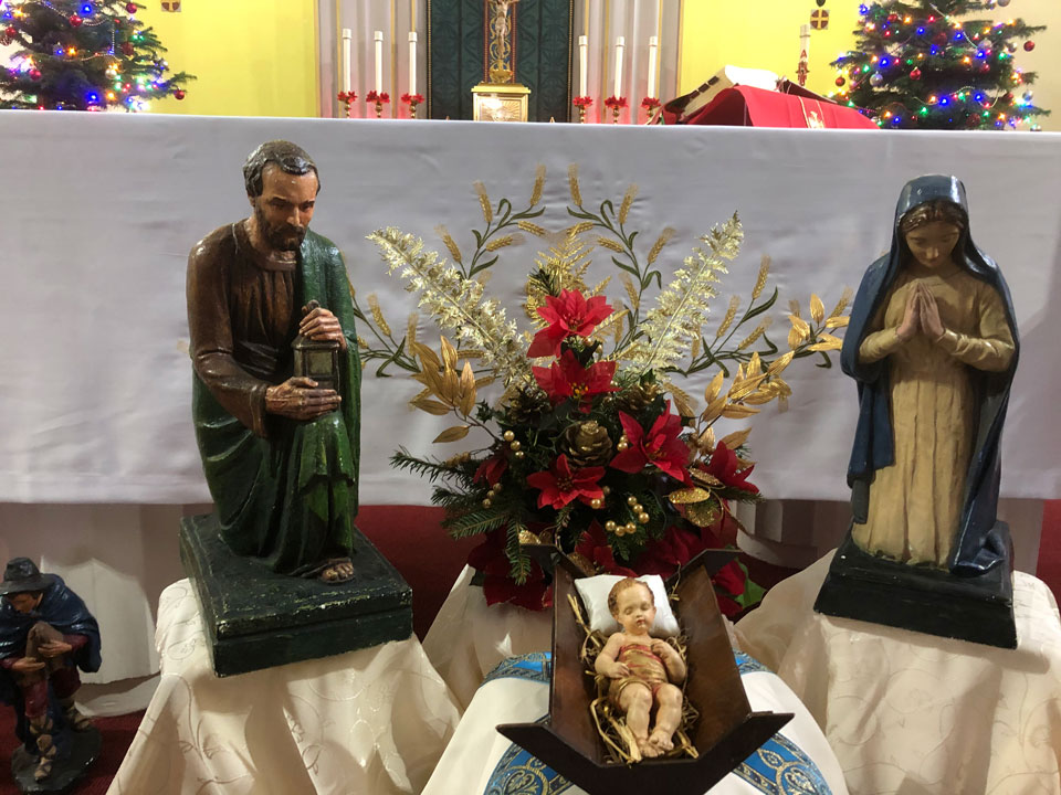 Close up of Jesus, Mary and Joseph in the Crib set inside St. Edward's church, 2020