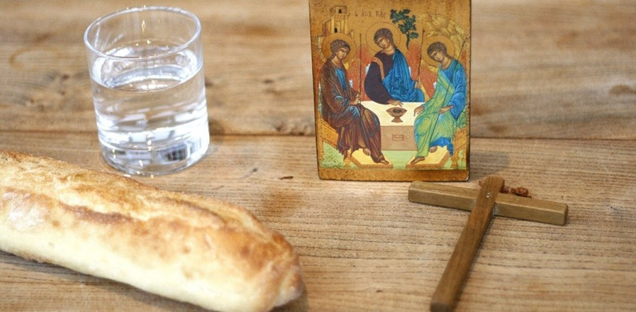 Bread, water, a religious icon and a cross