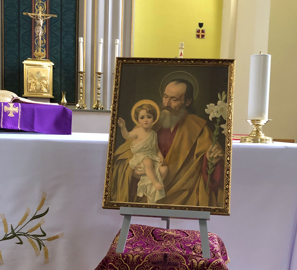 Image of St. Joseph in front of the altar at St. Edward's Church