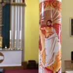 Easter Candle with Jesus risen image on it