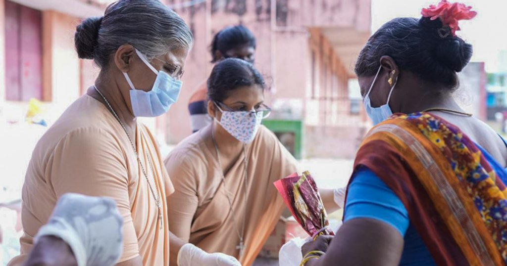 Three women in India in face masks against Covid - Image credit: CAFOD